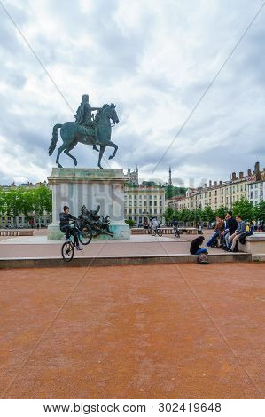 Lyon, France - May 09, 2019: The Equestrian Statue Of Louis Xiv, In Place Bellecour Square, With Loc