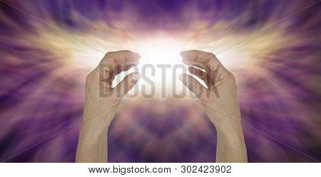 Sending Transcendental Healing Energy - Female Hands Opposite Each Other With A Bright White Light B