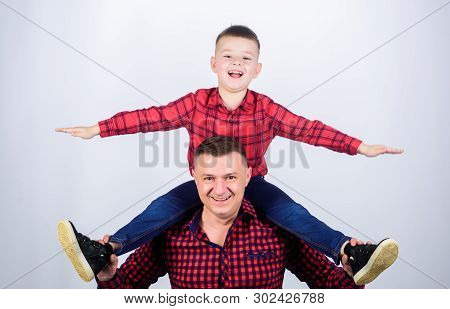Happiness being father of boy. Having fun. Fathers day. Father example of noble human. Family time. Best friends. Father little son red shirts family look outfit. Child riding on dads shoulders poster
