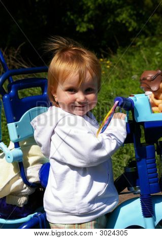 Girl And Her Tricycle