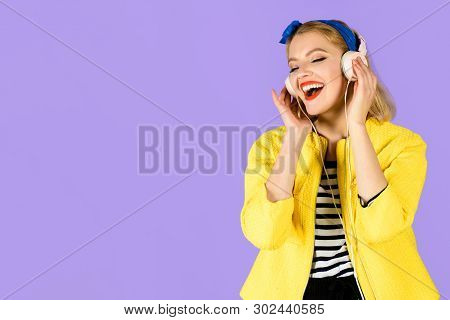Sexy Girl In Yellow Jacket With Earphones. Woman Enjoy Good Sound. Woman With Headphones Listening M