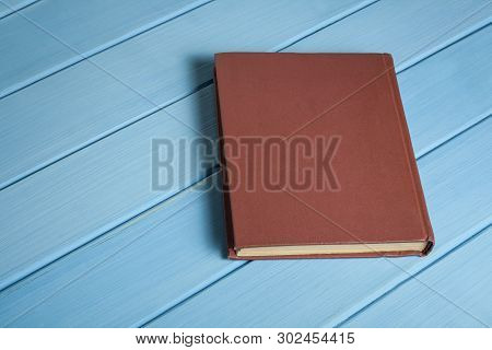 Old Book On Wooden Desk. Back To School. Education Background.