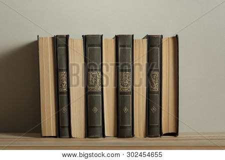 Stack Of Old Books On Wooden Desk Back To School. Education Background.