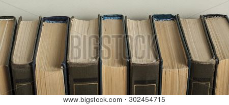 Stack Of Old Books On Wooden Desk. Copy Space For Text. Back To School. Education Background.