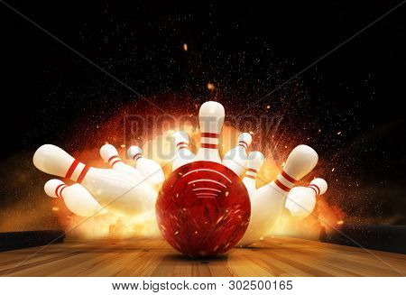 Bowling strike hit with fire explosion. Concept of success and win.