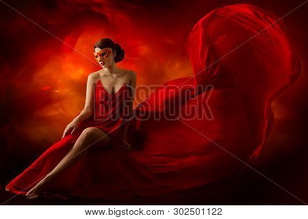 Sexy Woman In Carnival Mask, Fashion Model In Sensual Dress, Flying Fluttering Red Fabric