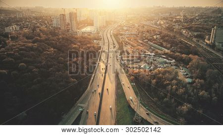 Urban Car Road Traffic Congestion Aerial View. City Street Motion Lane, Drive Navigation Overview. Busy Cityscape Speed Route with Forest Park Around. Travel Concept Drone Flight Shot poster