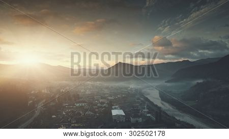 Sunrise mountain village misty weather aerial view