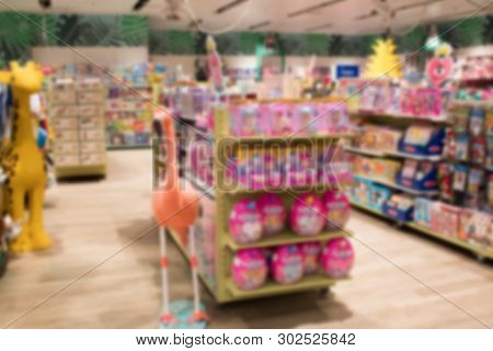 Abstract Blurred Image Of Shopping Mall Or Retail Store With Product Shelves. Shopping Center Showca
