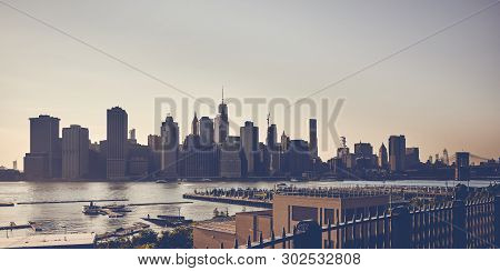Vintage Toned Picture Of New York City Silhouette Seen From The Brooklyn Heights Promenade At Sunset