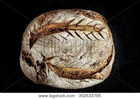 Loaf (or Miche) Of French Sourdough, Called As Well As Pain De Campagne, On Display Isolated On A Bl