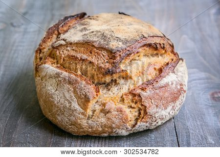Loaf (or Miche) Of French Sourdough, Called As Well As Pain De Campagne, On Display On A Wooden Tabl
