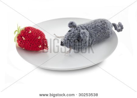 The Knitted Gray Mouse And Strawberry On The White Plate.