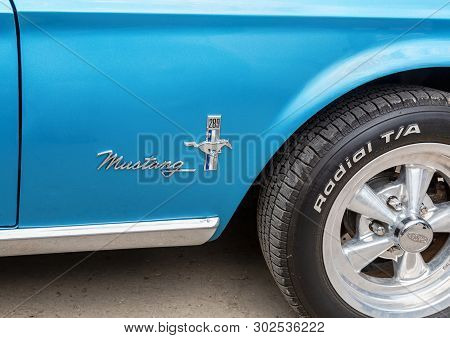 Samara, Russia - May 18, 2019: Emblem On The Retro Car Ford Mustang. The Ford Mustang Is An American