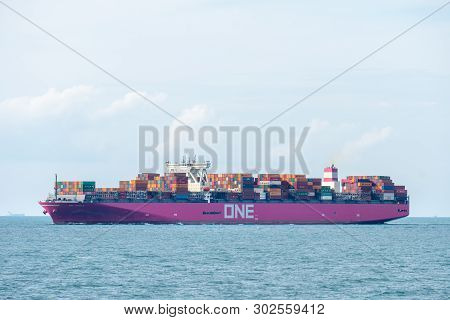 Singapore Strait, Singapore - April 13, 2019: Magenta Hull One Aquila Container Ship Of Ocean Networ