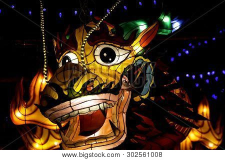 Face Of An Illuminated Asian Dragon At A Chinese Festival