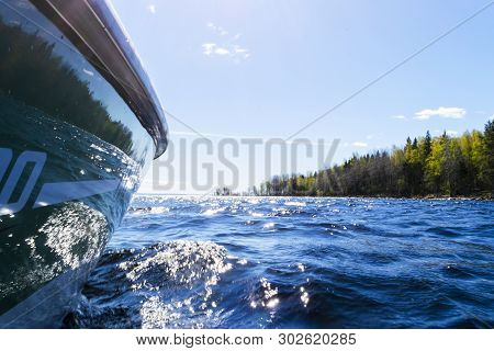 Side View Speeding Fishing Motor Boat With Drops Of Water. Blue Ocean Sea Water Wave Reflections Wit