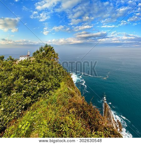 Getaria Lighthouse Is Located At The End Getaria Mouse (symbol Of Town), On Mount San Anton. Spain,