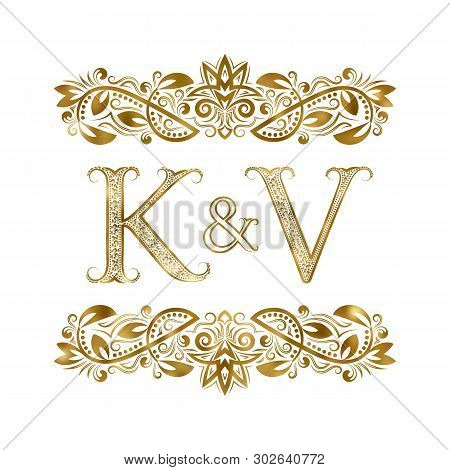 K And V Vintage Initials Logo Symbol. The Letters Are Surrounded By Ornamental Elements. Wedding Or