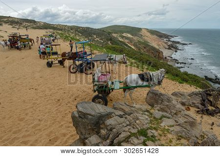 People And Horse Carriage At The Beach Near Jericoacoara On Brazil