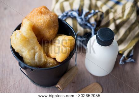 Deep Fried Dough Sticks And Fresh Milk As A Popular Morning Snack Served In Tang. Thai Called Patong