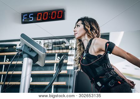 Ems Electro Stimulation Women Exercises With Coach In Modern Gym. Electric Muscle Stimulation Workou