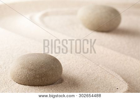 Yoga or spa wellness background of a Japanese zen garden. A round stone for concentration stands for harmony and purity.