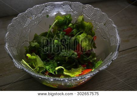 Glass Salad Bowl With Low Angle Lighting From Below.