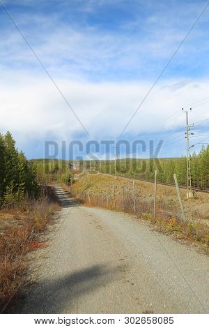 Road Besides Railroad Track In Lapland, Sweden.