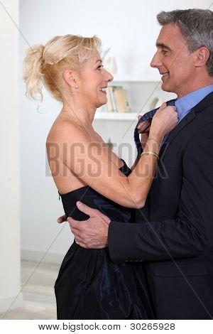 Woman fixing her husband's tie