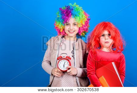 Are We In Time. Adorable Party Goers. Cute Children With Fancy Hair Waiting For Party Time With Cloc