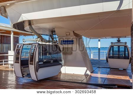 Lisbon, Portugal - April 2, 2018: Aerial Tramway with open doors in the terminal aka embarking or docking station in Parque das Nacoes aka Nations Park.