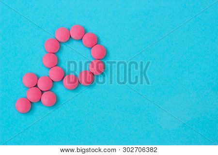 Medicine For Woman. Menopause, Pms, Menstruation Or Estrogen Concept. Female Health. Gender Symbol M