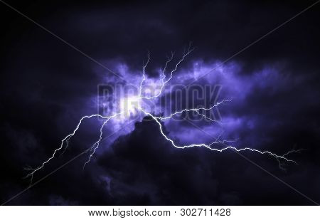 Lightning With Dramatic Clouds. Lightning Strike On The Dark Cloudy Sky.