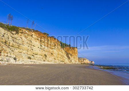 Praia Do Porto De Mos, Long Beach In Lagos, Algarve Region, Portugal. Beautiful Golden Beach, Surrou