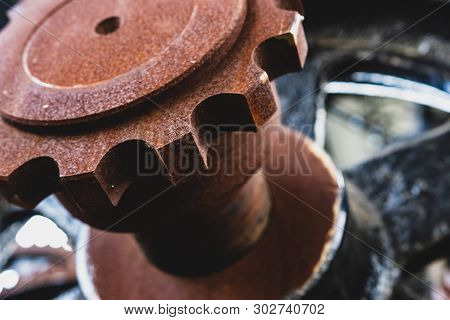 Large Rusty Industrial Gear At Angle In Daylight