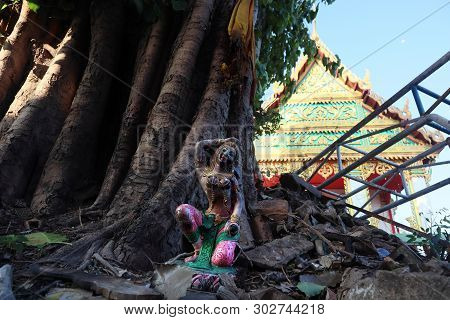 Damaged Buddha Image Was Placed Under A Large Tree At The Temple According To The Beliefs And Faith