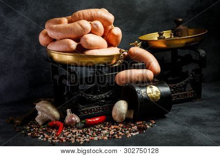 Bunch Of Thick Wieners In Spiral With Chili And Mushrooms