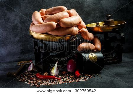 Heap Of Raw Thick Wieners With Spices, Onion And Chili