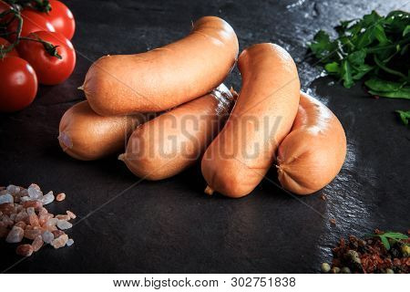 Macro Pile Of Raw Short Sausages With Rucola And Tomatoes