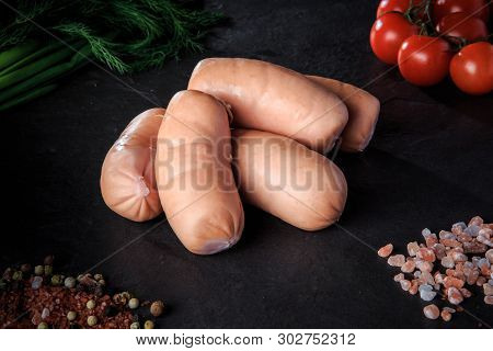 Closeup Group Of Short Sausages With Dill And Tomatoes