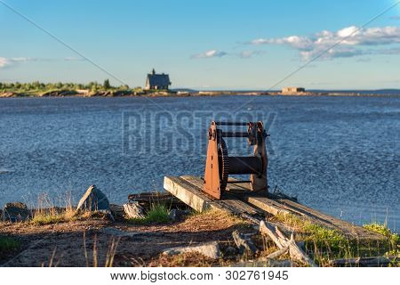 The Hull Of The Old Winch On The Shore In The Village Of Rabocheostrovsk, Kem.  White Sea, Kemsky Di