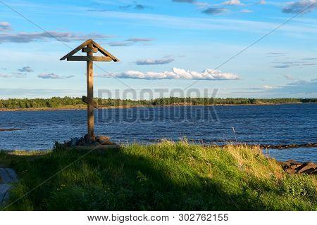 Worship Cross On The Shore Of The White Sea. The Village Of Rabocheostrovsk, Kem.  White Sea, Kemsky