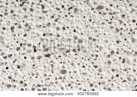 Macro Of Pumice Stone. Grey Porosity Stone, Rough Pumice Texture Background. High Resolution Photo.
