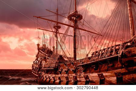 Re-production of a galleon in public site in Genova, Italy, stormy sky