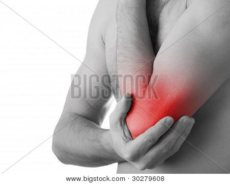 Rear View Of A Young Man Holding His Elbow In Pain, Isolated On White Background