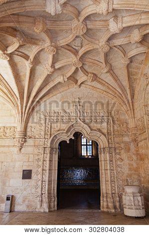Lisbon, Portugal - June 30, 2018: Manuelino or Manueline Gothic Refectory entrance. Ceiling with nervures or ribs. Jeronimos Monastery or Abbey aka Santa Maria de Belem