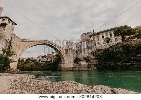 The Old Bridge In Mostar With Emerald River Neretva. Bosnia And Herzegovina. - Image