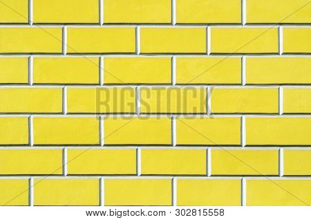 Brick wall background - new bricks wall pattern. Texture brick wall of yellow color