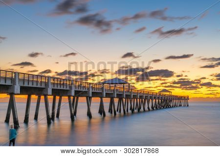 Juno, Florida, USA at the Juno Beach Pier just before sunrise.
